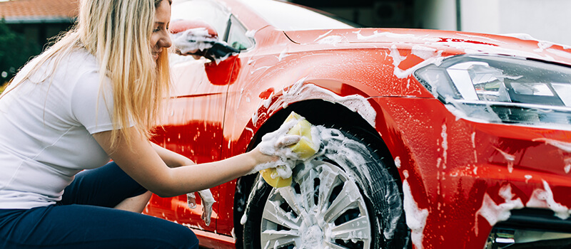 girl cleaning car